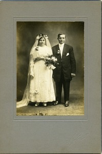 Polish American bride and groom: full-length studio portrait