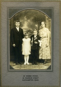 Lesinski family (Jan and Weronika, with children Stanley and Marya) at First Communion: full-length studio portrait of Polish American family