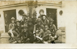 Ignacy Skarpetowski and fellow members of 1st Co., Coast Artillery Corps: posed with rifles aboard ship