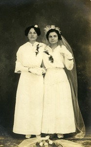 Polish American bride and bridesmaid, Weronika Skedzielewska (bridesmaid) and unidentified bride (l. to r.): full-length studio portrait