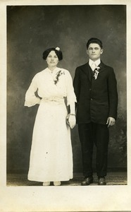 Polish American bride and bridesmaid, Weronika Skedzielewska (bridesmaid) and unidentified groomsman (l. to r.): full-length studio portrait