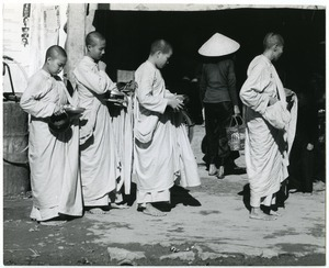 Buddhist nuns with begging bowls