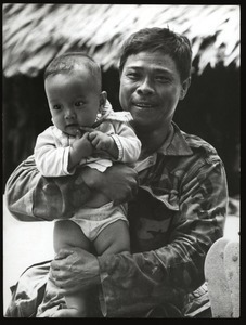 Soldier father with infant son