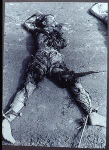 Child lying dead in war