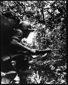 Teenage ARVN trooper running through the jungle