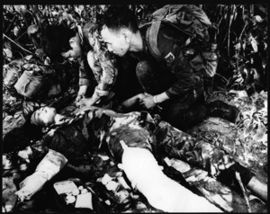 Two soldiers tend a wounded comrade