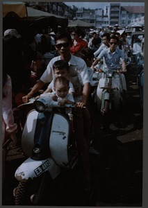 Father and sons on a scooter