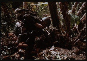 ARVN soldier approaches underground tunnel
