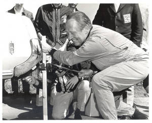 Art Linkletter changing a tire (1969)