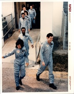 Crewmembers Stride Out of Operations and Checkout Building
