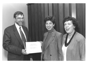 "Lois Lopaten is presented with a certificate at the ""Women at the Top"" event at Suffolk University"
