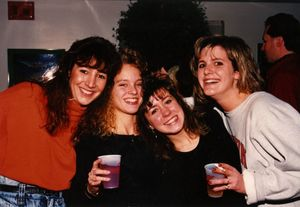 A group of Suffolk University students celebrate at a holiday party, 1990