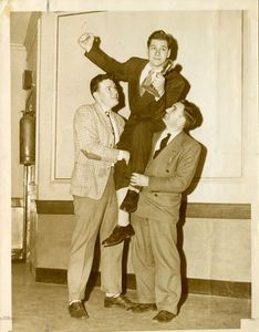 Dick Stukas celebrates with two classmates after winning the Suffolk University Law School oratorial contest