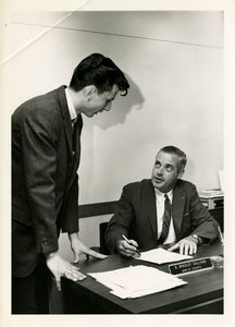 Suffolk University Dean of Students D. Bradley Sullivan, seated, with student