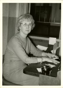 Kay Holland, Suffolk University's switchboard operator, seated at desk