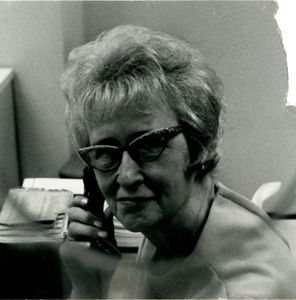Kay Holland, Suffolk University's switchboard operator, on the phone