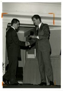 Suffolk University Athletics Director James E. Nelson presenting an award at the 1996 Recognition Day