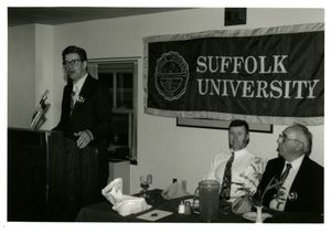 Athletics Director James E. Nelson speaking at Suffolk University's athletics banquet, 1994