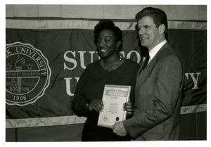 Athletics Director James E. Nelson presents Who's Who award to student Melissa De Lay at Suffolk University's 1994 Recognition Day