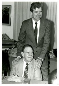 Athletics Director James E. Nelson and basketball team manager Charles Melanson (seated) at Suffolk University's athletics banquet, 1993