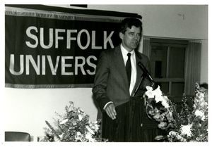 Athletics Director James E. Nelson speaking at Suffolk University's athletics banquet, 1993