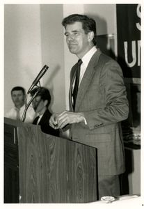 Athletics Director James E. Nelson speaking at Suffolk University's athletics banquet, 1990