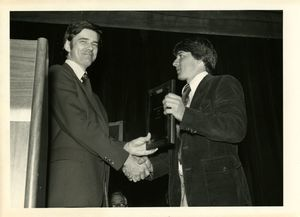 Athletics Director James E. Nelson presents award to student Jon Caron at Suffolk University's 1978 Recognition Day ceremony