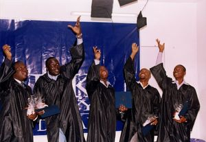 Graduates toss their caps at the 2010 Suffolk University commencement at the Dakar campus