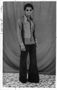 Abdulas Barrie of Suffolk University's International Studies Association, wearing sunglasses and bell bottoms, 1978