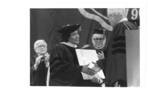Coretta Scott King receives a doctor of humane letters honorary degree from Suffolk University President David J. Sargent (1989-2010) at the 1997 commencement at the Fleet Center