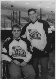 Suffolk University men's hockey player John Gilpatrick and coach Brian Horan, 2000