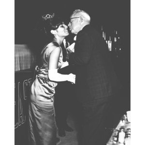 The 1968 Homecoming Queen greets a man at the Homecoming dinner