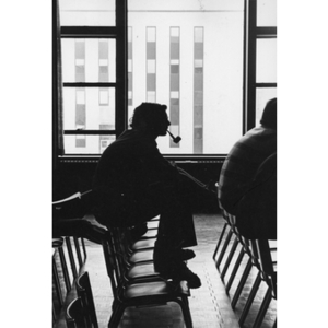 Silhouette of a student smoking a pipe
