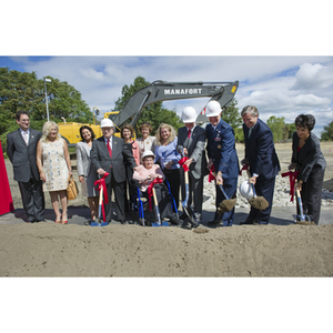 A group shovels dirt at the groundbreaking ceremony for the George J. Kostas Research Institute for Homeland Security