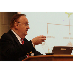 Barry Karger gestures from the podium at the NU Today Cancer Research Panel