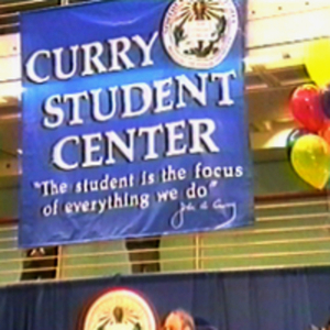 A banner with a President Curry quote hanging over the stage at the Curry Student Center dedication