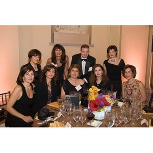 Eight women and a man pose together at the inauguration celebration for President Aoun