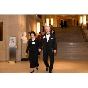 A couple walks through the Museum of Fine Arts at President Aoun's inauguration celebration