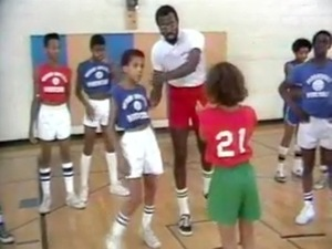 Tom Satch Sanders teaches basketball to African American children