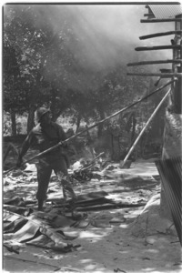 1st Infantry men destroying houses in Vietcong held area; Hau Nghia.