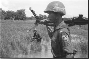 25th Division ARVN soldier patroling Can Giuoc's road.
