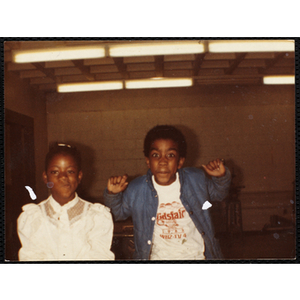 African American boy and girl posing together during a class at the Boys and Girls Club