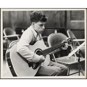 A Boys' Clubs of Boston member playing guitar
