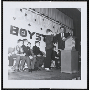 A boy takes an oath at a Boys' Club of Boston St. Patrick's Day inaugural ball and exercises event