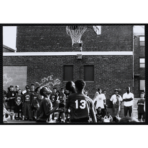 Players vie for a rebound during a Chelsea Housing Authority Basketball League game