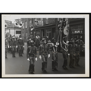 Boy Scouts from Troop 57 marching in a parade