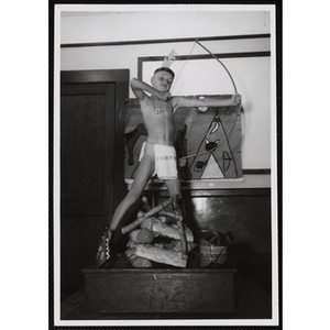 Boy pretending to shoot a bow and arrow in the Indians club