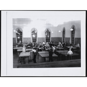 About fifty boys playing in the Junior Games Room at the South Boston Boys' Club