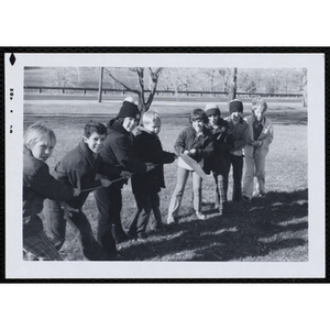 Boys pose for a group shot while playing tug of war