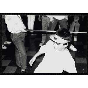 A Boy smiles after taking his turn in the limbo contest